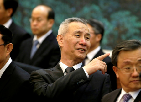 FILE PHOTO: Liu He, vice chairman of the National Development and Reform Commission (NDRC), attends a signing ceremony in Beijing